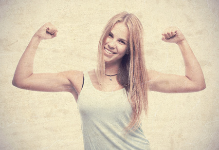 young cool woman strong pose photo