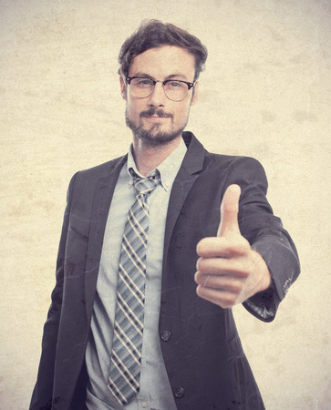 conform: young crazy businessman all right gesture Stock Photo