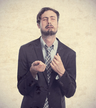 slight: young crazy businessman crying Stock Photo