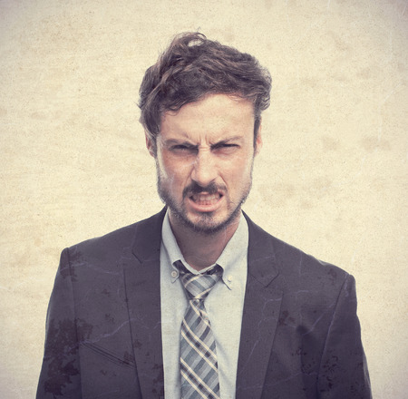 young crazy businessman angry face photo