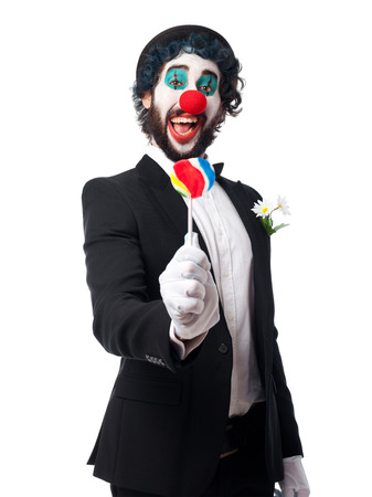 lolly pop: clown with a lolly pop Stock Photo