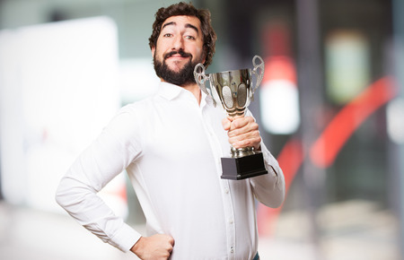 man with a champion cup