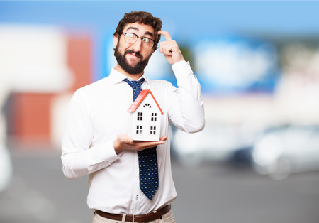 businessman with a house photo