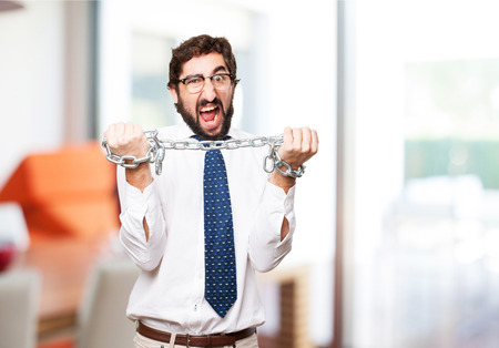 prison ball: businessman with a chain Stock Photo