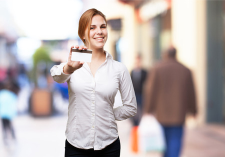 blond woman with credit card photo