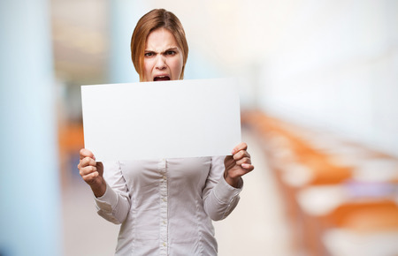 a placard: blond woman with a placard Stock Photo