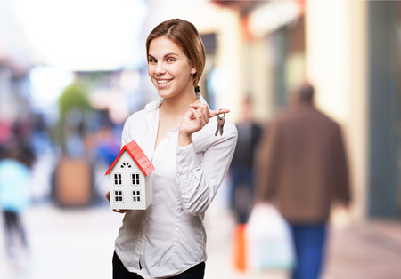 sold small: blond woman with a small house and keys