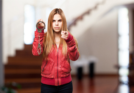 woman handcuffs: blond woman with handcuffs Stock Photo