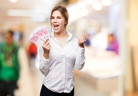 blond woman with money Stock Photo