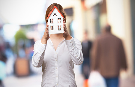 a small house: blond woman with a small house Stock Photo