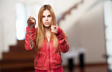 blond woman with handcuffs Stock Photo