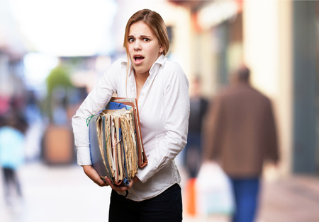 blond woman with files photo