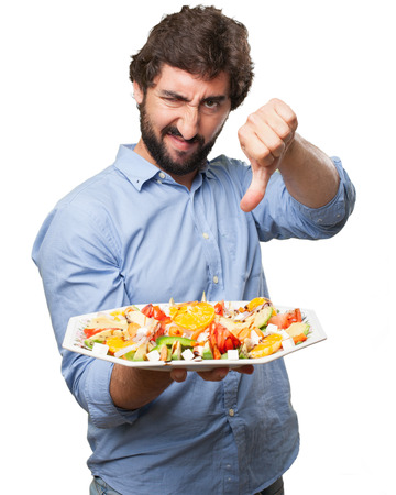 huffy: angry young man with salad Stock Photo