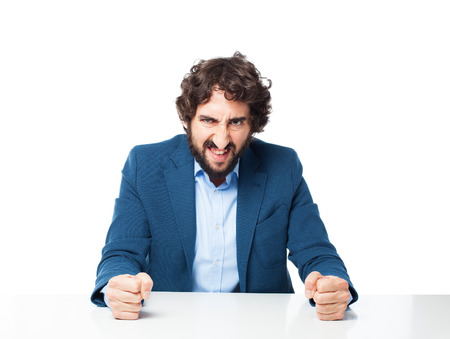 bothered: angry businessman with sit table