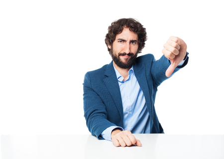 provoked: angry businessman thumb down concept Stock Photo
