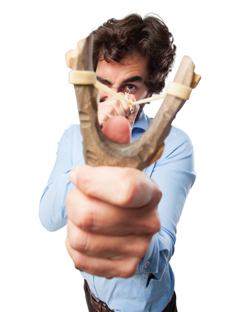 huffy: angry young man with slingshot Stock Photo