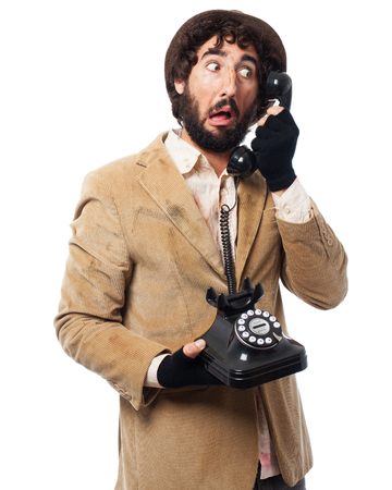 crazy homeless man with telephone