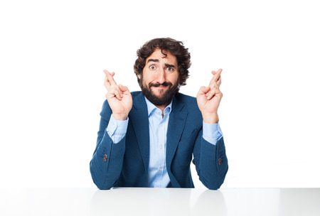 fingers: stressed businessman cross fingers Stock Photo
