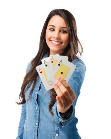 happy young woman with poker cards