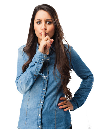 huffy: angry young woman silence gesture Stock Photo