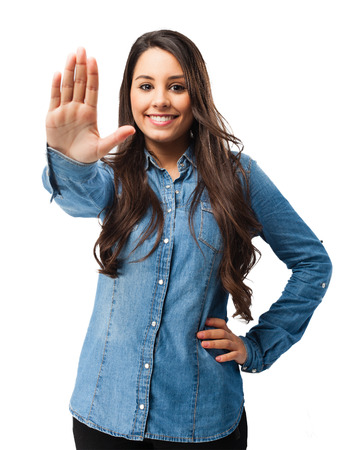 stop gesture: happy young woman stop gesture Stock Photo