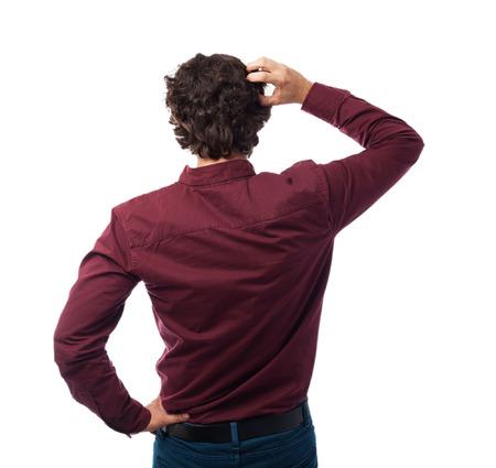 massage homme: Retour jeune homme la pensée Banque d'images