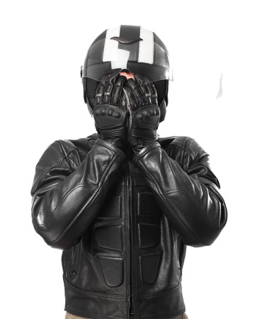 covering the face: scared biker covering face Stock Photo