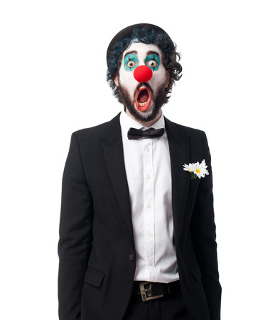 desperate face: crazy clown man surprised pose Stock Photo