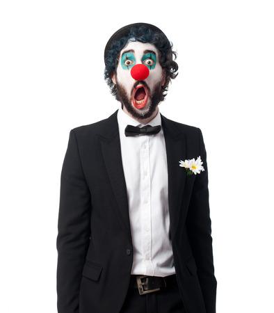 crazy clown man surprised pose Stockfoto