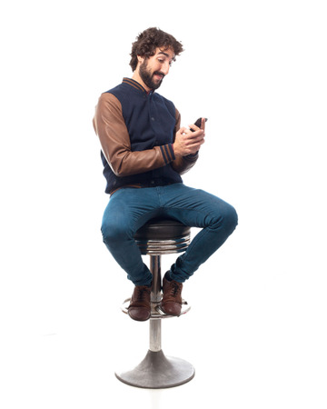 bar stool: young man with mobile bar stool Stock Photo