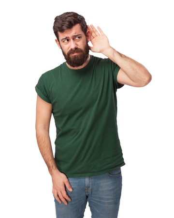 heed: confused young man listening Stock Photo