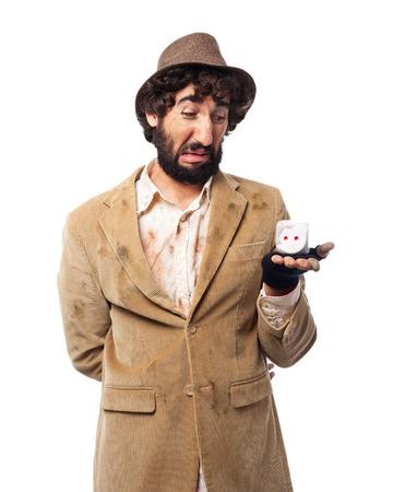 hobo: sad homeless man with dice Stock Photo