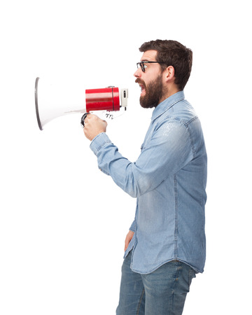huffy: angry young man with megaphone Stock Photo
