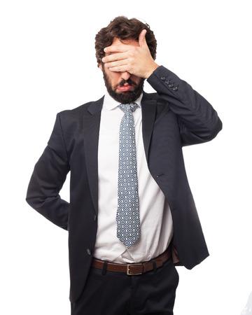 covering eyes: sad businessman covering eyes