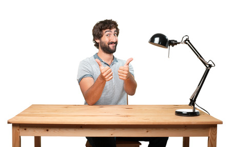 allright: crazy young man with table .happy expression