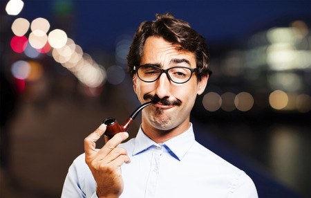 young cool man with a pipe Stock Photo