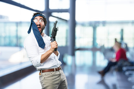 young funny man with machine gun.disagree expression Stock Photo