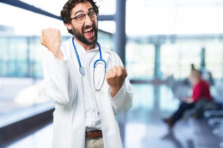 재미 있은 젊은이 성공 포즈. 의사 개념 스톡 콘텐츠