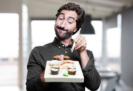 tonto: young man eating sushi. show sign