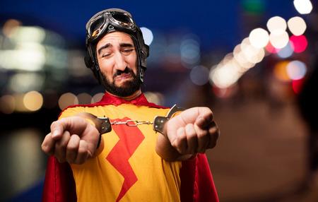 crazy super hero with handcuffs Stock Photo