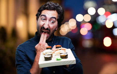 young man eating sushi. vomit sign
