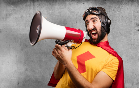 crazy super hero with a megaphone Stock Photo
