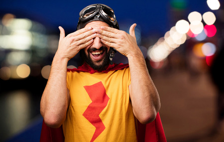 crazy super hero covering eyes gesture