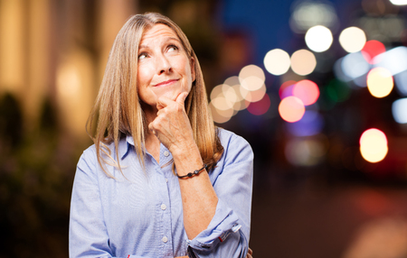 dudando: senior beautiful woman doubting
