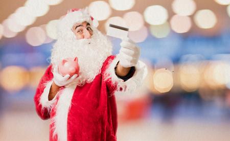 christmas debt: santa claus with savings Stock Photo
