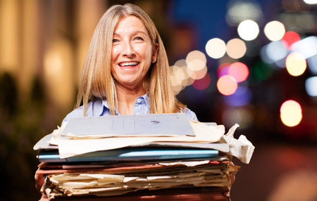 senior beautiful woman with files