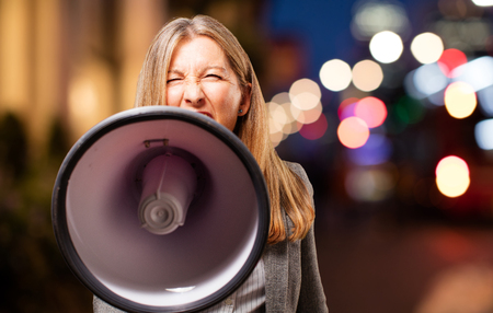 senior beautiful woman with megaphone