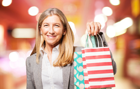 senior beautiful woman with shopping bags Stock Photo