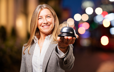 senior beautiful woman with ring bell Stock Photo