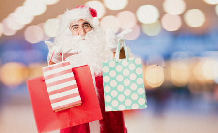 xmass: santa claus with shopping bags